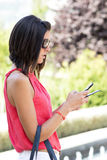 Woman using phone. Stock Image