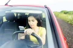 Woman using phone Royalty Free Stock Image