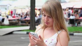 Woman using a phone stock footage