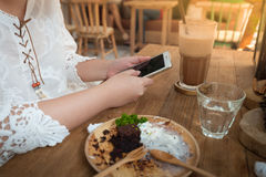 Woman using phone in cafe Stock Photography