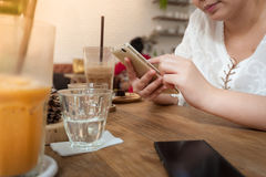 Woman using phone in cafe Royalty Free Stock Photo