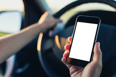 Woman using phone in the car Stock Photo