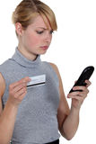 Woman using a phone card Stock Photo