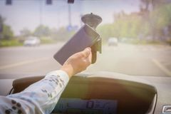 Woman using phone while driving the car Stock Images