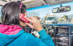 Woman using phone while driving a car stock images