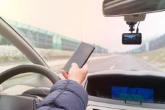Woman using phone while driving the car stock photos