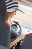 Woman using phone while driving her car Stock Photo
