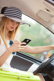 Woman using phone while driving her car Royalty Free Stock Photography