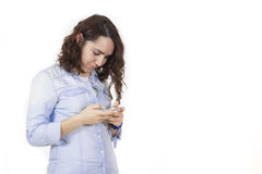 Woman using phone and smiling Royalty Free Stock Photo