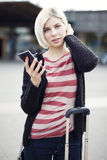 Woman using phone when traveling with public transport Royalty Free Stock Image