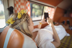 Woman using phone in van Royalty Free Stock Images
