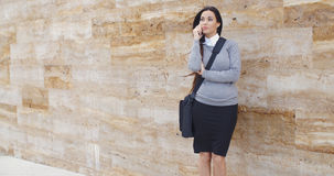 Woman using phone and waiting on hold Royalty Free Stock Images
