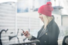 Woman using phone while waiting for a suburban train Stock Photography