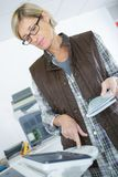 Woman using photocopier in creative office. Office-equipment Royalty Free Stock Photos