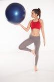 Woman using a pilates ball Royalty Free Stock Image