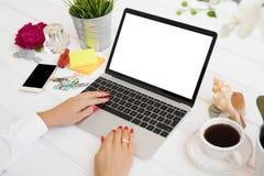 Woman using portable computer. Laptop mockup. Royalty Free Stock Photo