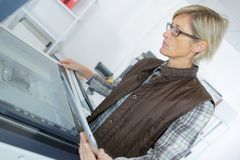 Woman using printer on table. Woman royalty free stock photography