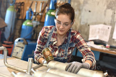 Woman using protective glasses working on metal Royalty Free Stock Photos
