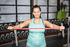 Woman using resistance band Royalty Free Stock Images