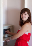 Woman using safe at hotel room Stock Photos