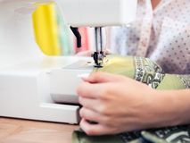 Woman using a sewing machine Royalty Free Stock Photos
