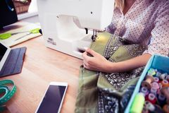 Woman using a sewing machine Stock Photo