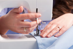Woman using sewing machine Royalty Free Stock Image