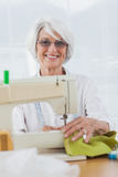 Woman using the sewing machine Stock Photo