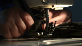 Woman using sewing machine. stock video footage