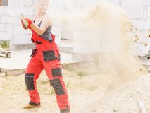 Woman using shovel on constriction site royalty free stock photo