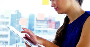 Woman using smart device in office stock video