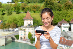 Woman using smart phone app in Bern Switzerland Stock Photos