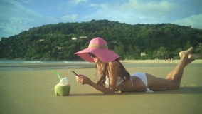 Woman Using Smart Phone On The Beach stock video