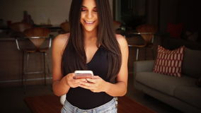 Woman using smart phone. Beautiful exotic woman with long dark hair using smart phone stock footage