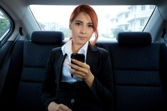 Woman using a smart phone Stock Photography