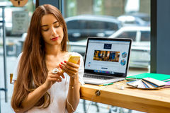 Woman using smart phone in the cafe Royalty Free Stock Photo