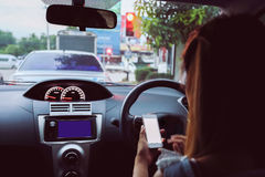 Woman using smart phone in car Royalty Free Stock Photo