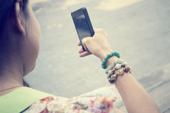 Woman using smart phone Stock Image