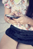 Woman using smart phone Royalty Free Stock Photos