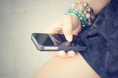 Woman using smart phone Stock Photos