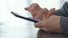Woman using smart phone. Close up a woman using smart phone stock video footage
