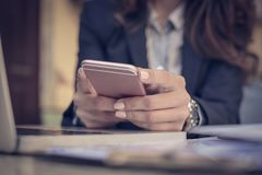 Woman using smart phone, Focus on phone. Close up. Business woman Royalty Free Stock Photo