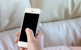 Woman Using a Smart Phone. Woman hold Using a Smart Phone Stock Images