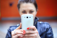 Woman using smart phone mobile. Royalty Free Stock Photography