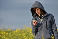 Woman using smart phone in the nature Stock Images