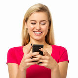 Woman Using Smart Phone Over White Background Stock Image