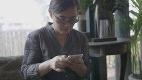 Woman using smart phone in restaurant. stock footage