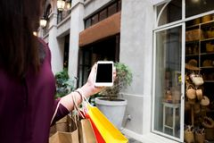 Woman using smart phone for shopping online in shopping mall. royalty free stock photo