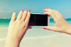 Woman using smart phone for taking outdoor photo Stock Images