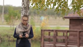 Woman using smart phone typing message outdoor.  stock video footage